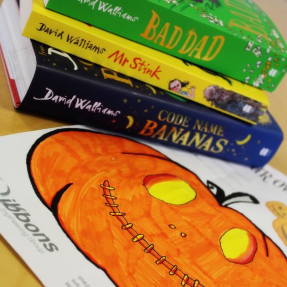 orange pumpkin and books